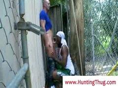 Darksome ghetto guy sucking white cock in the alley