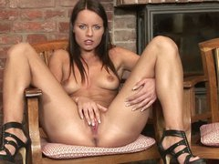 Naked brunette chick Kari in high heels spreads her legs on a chair to stroke her shaved pussy in front of you. She does it by the fireplace. Watch Kari make herself happy!